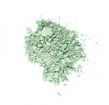 En liten hög med ljusgrönt pigment