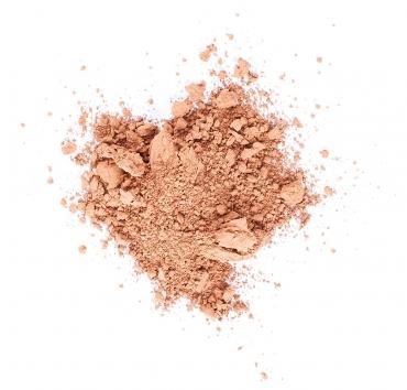 En liten hög med laxrosa pigment