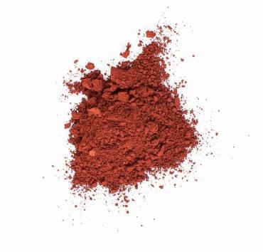 En liten hög med djuprött pigment
